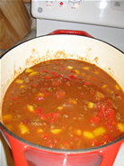 chili with meat, beans, and tomatoes